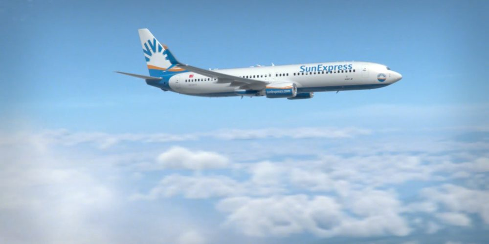 SunExpress aircraft above clouds