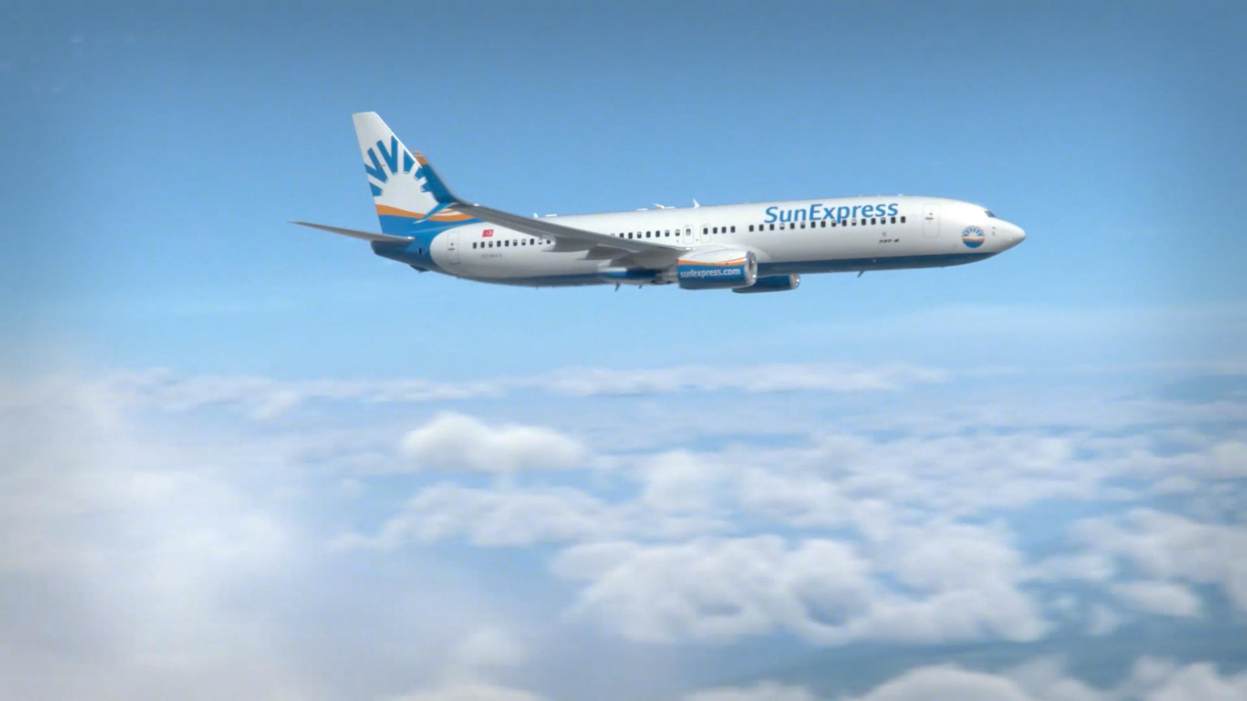 SunExpress aircraft above clouds